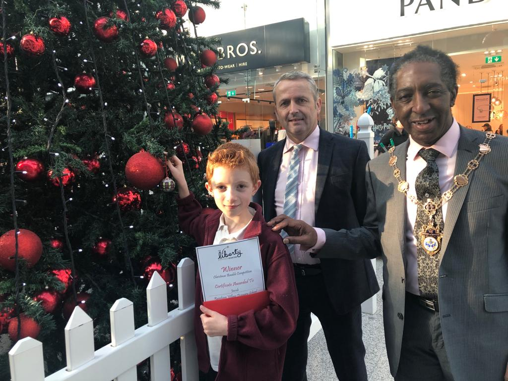 Jacob, 10 from Rainham Village Primary School and Nursery with Centre Manager at The Liberty, Jonathan Poole and The Mayor of Havering, Michael Deon Burton