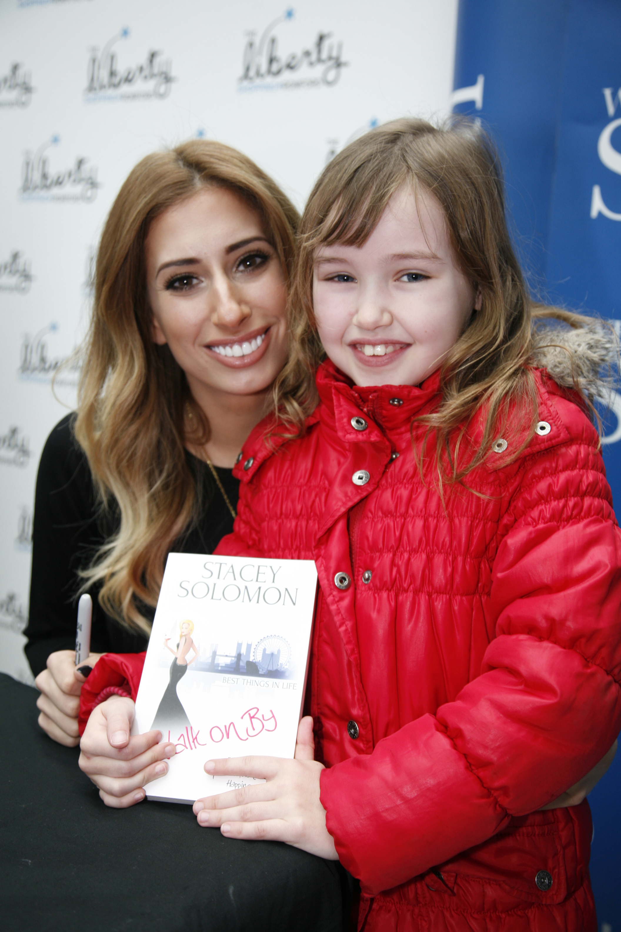 Stacey Solomon with the first fan in the queue (Copyright S Rowse)