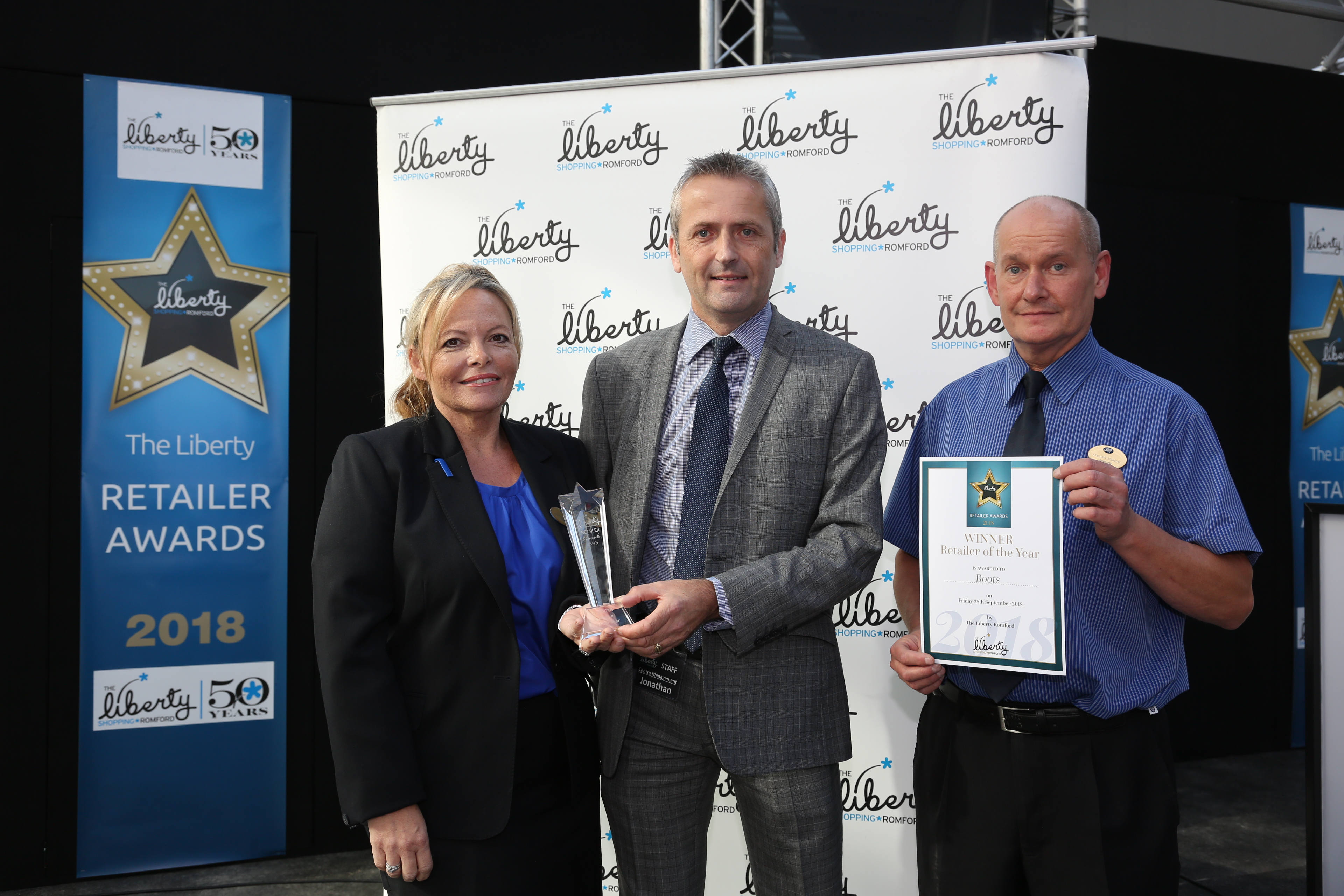 Image: S.Rowse. Retailer of the year award Winner: Belinda Pritchard from Boots, Centre Manager Jonathan Poole, winner: Tony Webb from, Boots