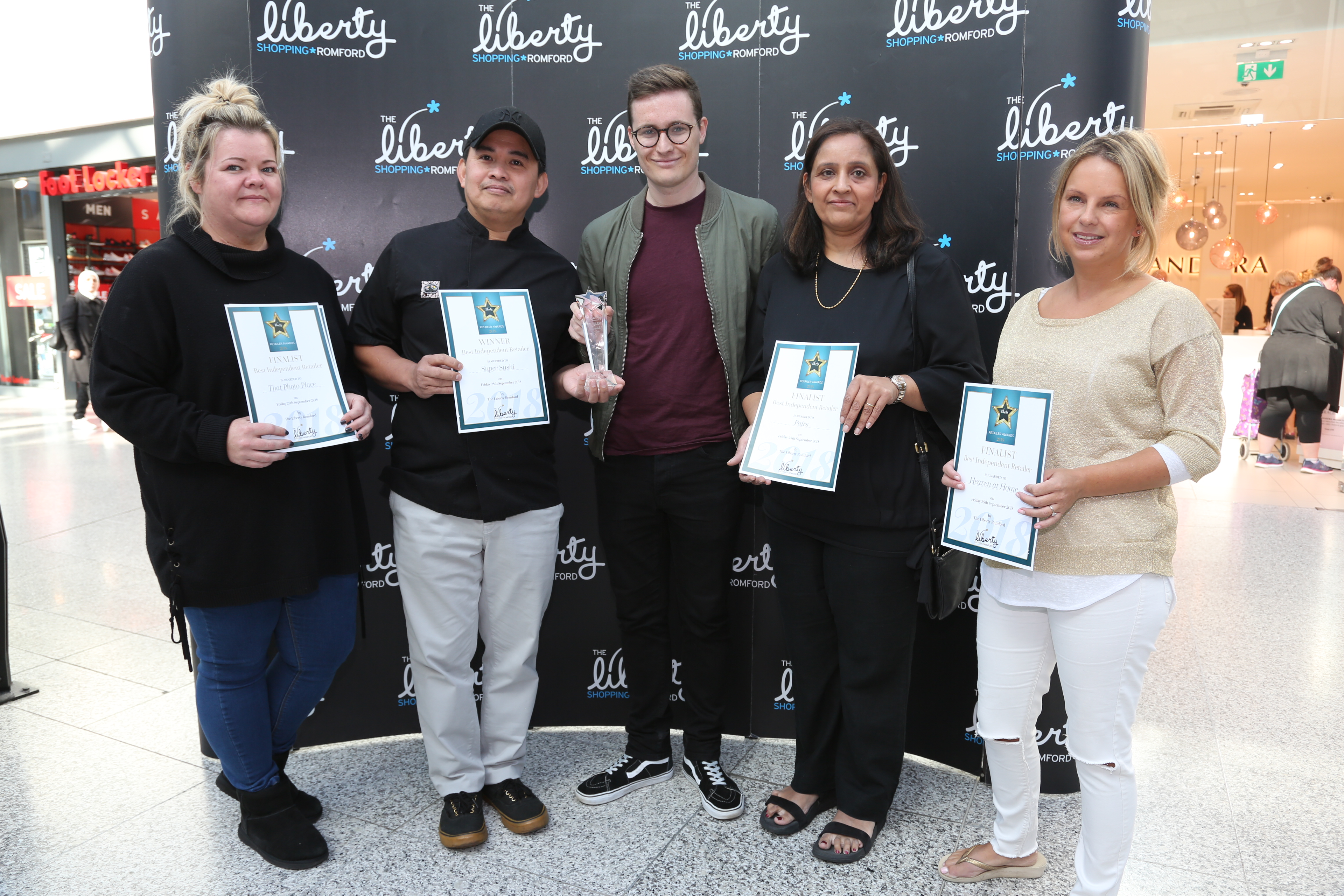 Image: S.Rowse. Independent Retailer, Kelly Smith on behalf of Finalist Kerrie O'Neil from That Photo Place, Winner Gonzalez from Super Sushi, with Haydn Jeavon from Time 107.5 fm radio, Kin Rana from Pairs, Lisa Bignall from Heaven at Home