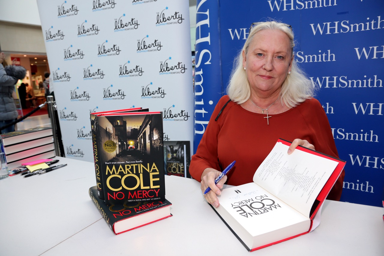 Signing books (Photo by Sandra Rowse)